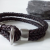 Mørkebrunt flettet læderarmbånd